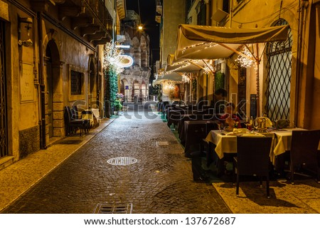 Outdoor Restaurant in the Sidewalk of Piazza Bra in Verona, Veneto, Italy - stock photo