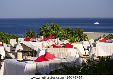 Outdoor restaurant overlooking the sea - stock photo