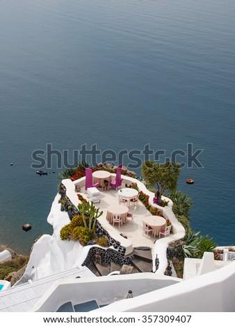 Outdoor restaurant, Santorini island - stock photo