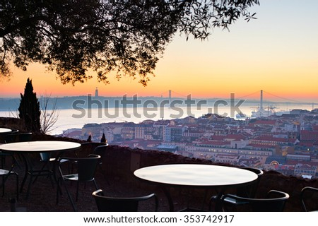 Outdoor restaurant with fantastic view of Lisbon at sunset. Portugal - stock photo