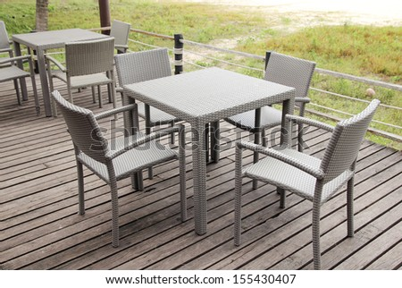 Outdoor restaurant with tables and chairs in resort - stock photo