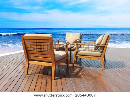 outdoor restaurant with views of sea - stock photo