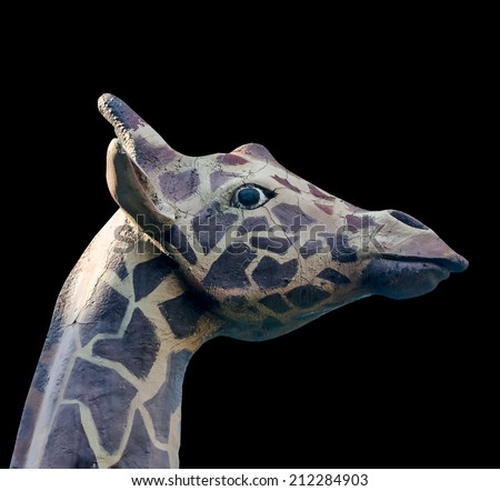 Outdoor sculpture head of a giraffe, close up, isolated, black background - stock photo