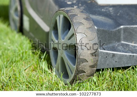 Outdoor shot of a lawn mower - stock photo