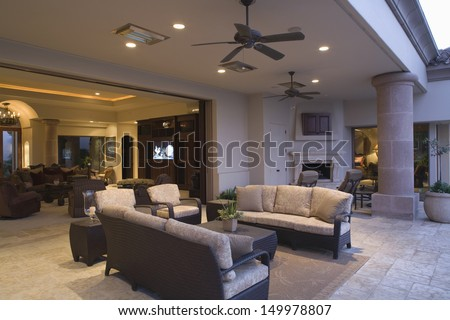 Outdoor sitting area with view of living room in the background - stock photo