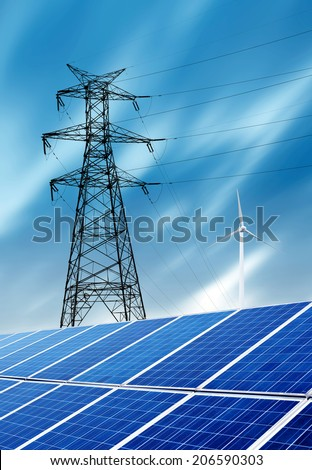Outdoor, solar panels and high-voltage tower and wind turbine under a blue sky. - stock photo