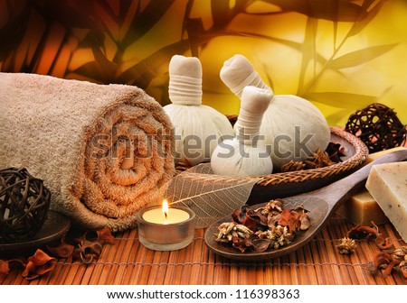 Outdoor spa massage setting at sunset with candlelight - stock photo