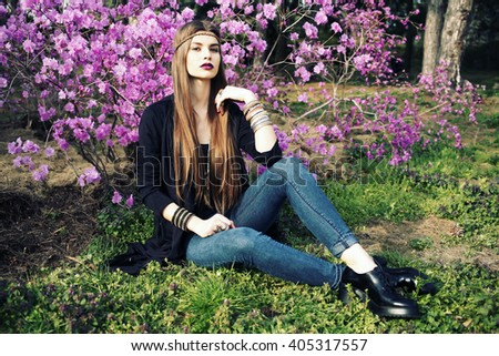 Outdoor street style high fashion portrait of young woman model, posing with trendy accessories and boho style clothes. Fashion blogger outfit.  - stock photo