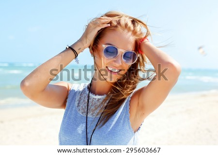 Outdoor summer colorful portrait of pretty young beautiful woman having fun on the beach  - stock photo