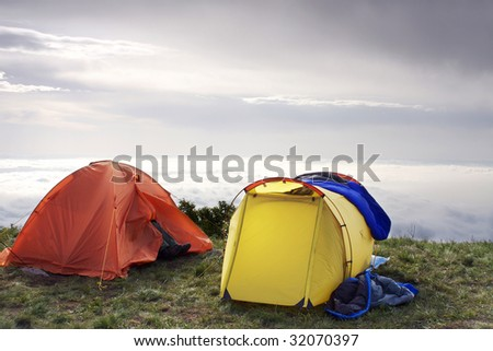 outdoor tent with the grand cloudscape background - stock photo