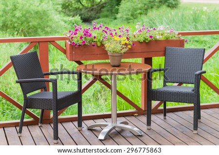 Outdoor terrace cafe table with two chairs - stock photo