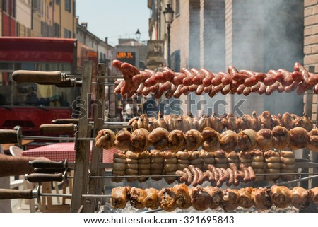 Outdoor Vertical Grilled Meat with Chicken, Pork and sausages - stock photo