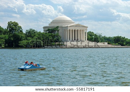 Outdoor view of Jefferson Memorial in Washington DC with beautiful blue sky in background. - stock photo