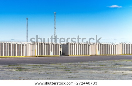 Outdoor view of many warehouses over blue sky. - stock photo