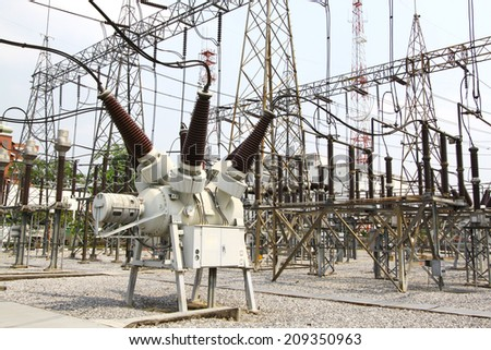 Outdoor with high voltage switchgear in electrical substation to generate electricity  - stock photo