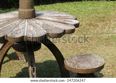 Outdoor wooden table and chairs in yard. - stock photo