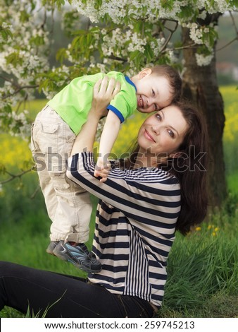 Outdoor young woman with her son - stock photo