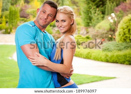 Outdoors portrait of a very fit attractive young couple. - stock photo
