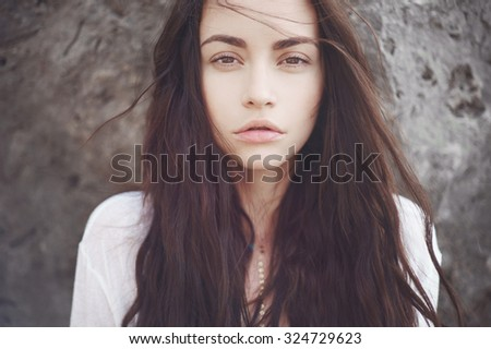 Outdoors portrait of beautiful romantic lady with magnificent hair - stock photo