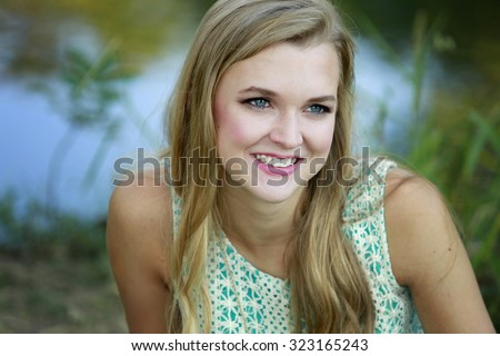 Outdoors portrait of beautiful young blonde girl  - stock photo