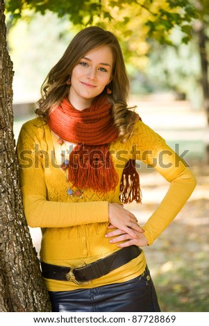 Outdoors portrait of colorful clothed gorgeous fall fashion girl. - stock photo