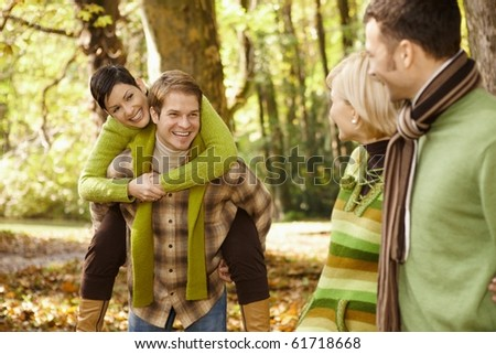 Outdoors portrait of happy young friends having fun in autumn park.? - stock photo