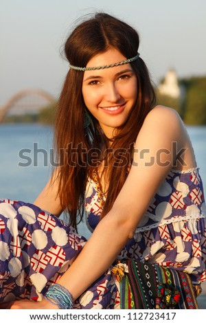 Outdoors summer portrait of beautiful young teen girl - stock photo