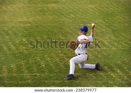 Outfielder Pitching Ball - stock photo