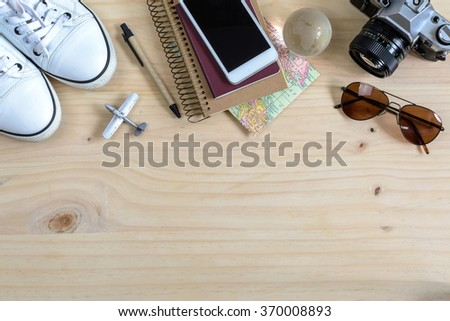 Outfit of traveler on wooden background and copy space,Travel concept - stock photo