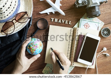 Outfits and accessories of traveler on wooden background with copy space, Travel concept - stock photo