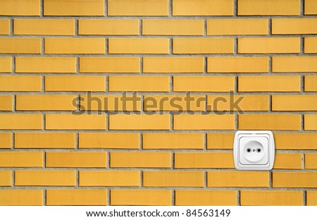 Outlet On A Brick Wall - stock photo
