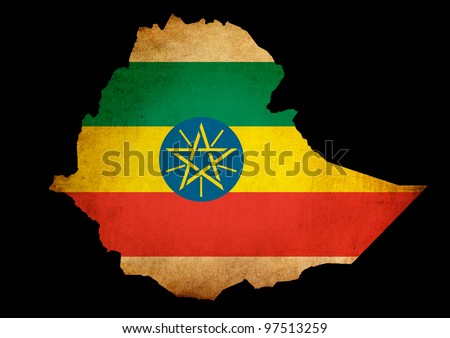 Outline map of Ethiopia with flag and grunge paper effect - stock photo