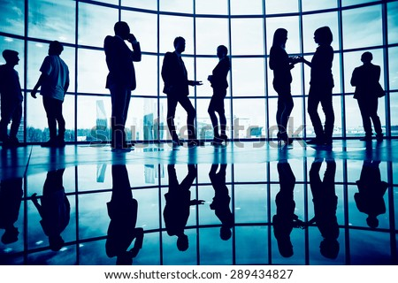 Outlines of business people communicating against window inside office building - stock photo