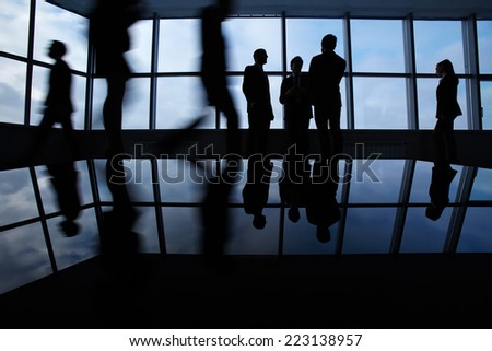 Outlines of business people, meeting, communicating and walking in office lobby  - stock photo