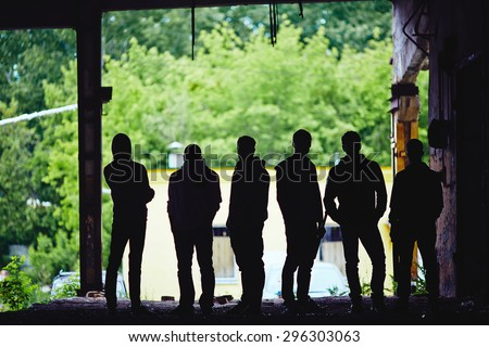 Outlines of gangster team outside - stock photo