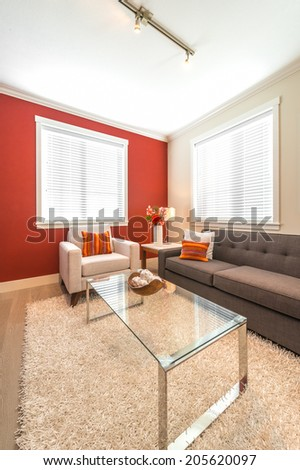 Outlook at the luxury modern living suite : living room with modern chair and dining suite and the kitchen at the back.  Interior design of a brand new house. - stock photo