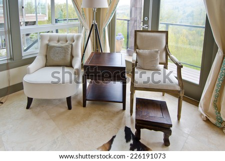 Outlook at the luxury spacious modern living room with the leather sofa, coach and chairs. Interior design. - stock photo