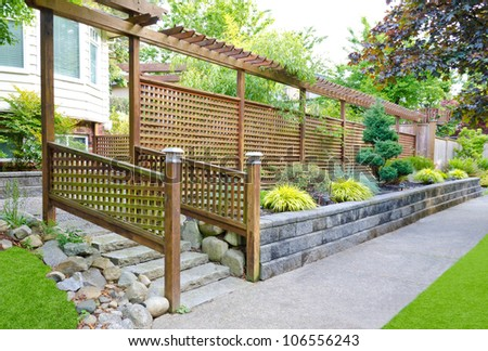 Outlook of the wooden asian style fence in front of the house. - stock photo