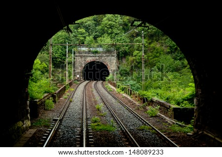 outside and inside railway tunnels - stock photo
