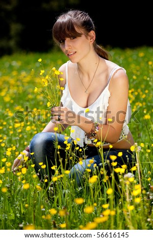 outside during a summer Teenager enjoying good weather day in the park. - stock photo
