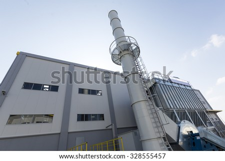 Outside of a waste management facility. Treatment and disposal of waste. Prevention of waste production through in-process modification, reuse and recycling. Convert waste materials into new products. - stock photo