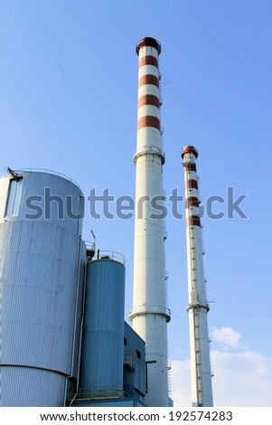 outside of the factory with smokestack in north Italy  - stock photo