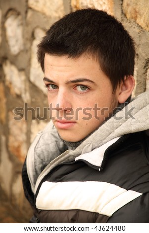 Outside portrait of a young man - stock photo