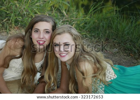 Outside portrait of beautiful sisters-teenagers - stock photo