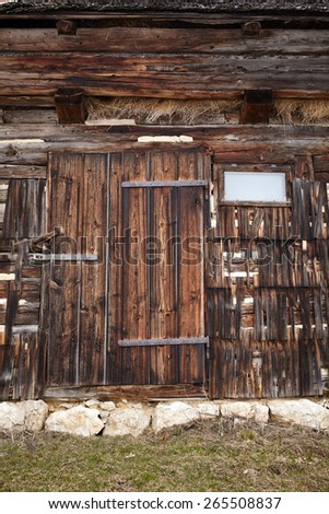 Outside view of an old wooden barn door with vintage look - stock photo