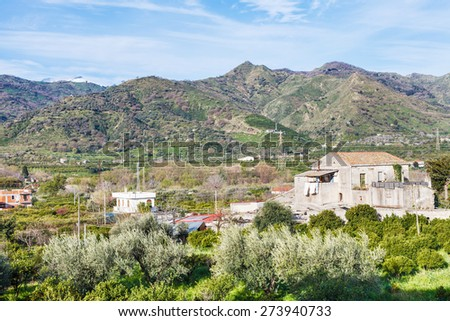 Outskirts of town Gaggi in green hills in spring day, Sicily, Italy - stock photo