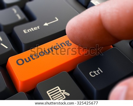 Outsourcing Concept. Person Click on Orange Keyboard Button. Selective Focus. Closeup View. - stock photo