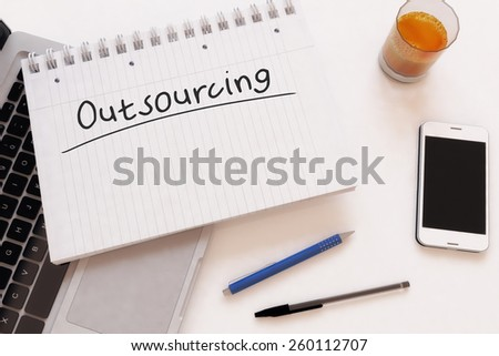 Outsourcing - handwritten text in a notebook on a desk - 3d render illustration. - stock photo