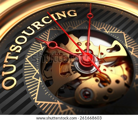 Outsourcing on Black-Golden Watch Face with Watch Mechanism. Full Frame Closeup. - stock photo