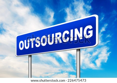 Outsourcing Road Sign with a blue sky in a background - stock photo